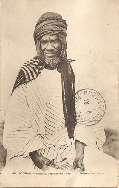 The photo, by photographer Edmond Fortier, shows the Dioula warlord Samory Touré wearing on his head a plain fringed indigo headscarf called a diisa. 1898.