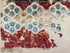 Fresco of decorative patterns in the form of rosettes from the bronze age excavation at Akrotiri on the island of Santorini