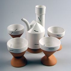 Paul Eshelman Tea Set - The American Museum of Ceramic Art has some great pieces in their collection (which you can see here) but this tea set by Paul Eshelman really caught me eye. Created in 1985 the slip cast red stoneware has a minimal Memphis vibe which I'm loving. How great would it be to bust this out after a nice dinner party?