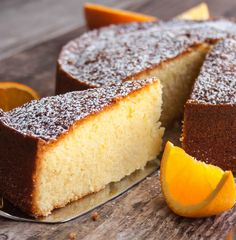 Orange Olive Oil Cake. A refreshingly light tasting yet very moist cake made with fresh squeezed orange juice, orange zest and your favorite mild olive oil