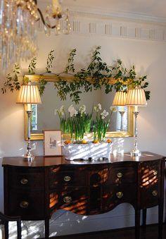 Very pretty sideboard. Love white daffodils