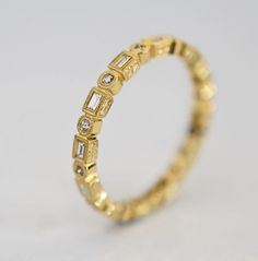 I could absolutely be ok with wearing this the rest of my life if it were a little less yellow. eternity ring in 18k