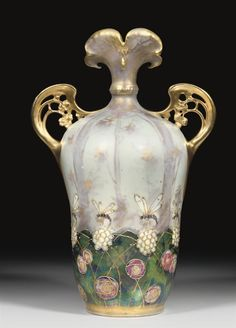 PAUL DACHSEL FOR AMPHORA; RIESSNER, STELLMACHER & KESSEL - LIFE IN THE FOREST' A TWIN-HANDLED PORCELAIN VASE, DESIGNED CIRCA 1900.