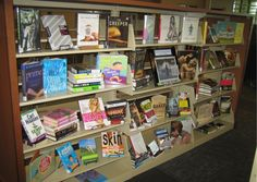 Did you know there is a Nude Recreational Week? We didn't either until we saw an article in our local newspaper. We cut out the article & displayed it with books that have the word naked or bare in the title.