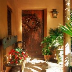 After passing through the courtyard, arriving at the front door of an adobe home offers another welcoming opportunity.