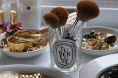 Diptyque candle holder re-purposed as a brush keeper