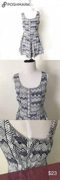 Back bow romper Beautiful white and blue dress like romper. Perfect for the summer! Brand new. Low back that looks like a bow. Size small 4-6 Dresses Mini