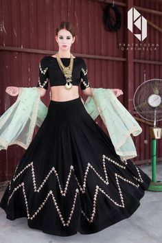 Looking for Black lehenga crop top? Browse of latest bridal photos, lehenga & jewelry designs, decor ideas, etc. Lehenga Choli Designs, Indian Lehenga, Bollywood Lehenga, Indian Wedding Outfits, Indian Outfits, Indian Designer Outfits, Designer Dresses, Designer Clothing, Black And Gold Lehenga