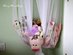 Canopy for over the bed turned into a stuffed animal storage but only tying a knot at the bottom. Genius!!  This way the kids can actually reach the stuffed animals.