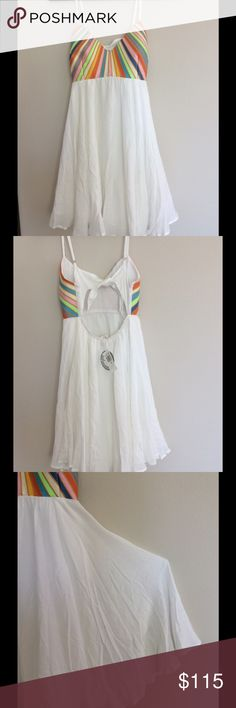 Mara Hoffman - Rainbow Embroidered White Dress Style: 15SS-9153-WHT Color: White Retail $275.00  Look lovely and ladylike in this stunning Mara Hoffman™ dress. Soft crinkled gauze constructs this feminine dress. Colorful embroidery decorates the bodice. V-neckline and sleeveless construction.  Adjustable shoulder straps. Tie closure at back with sleek cutout. Flared skirt falls at the knee. Combo: 100% cotton; Lining: 100% rayon. Dry clean only. Mara Hoffman Dresses Mini