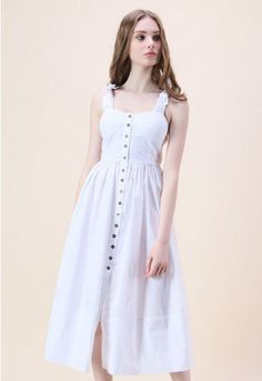 A shell white hue, button-down detail and bow-tie straps gives this dress an alluring girl-next-door vibe. Step out in chic mules and a vintage-esque crossbody bag for a boho-inspired look.  - Self-tie cami straps - Buttons through front - Padded bust - Elastic band on back - Not lined - 100% Polyester - Hand wash  Size(cm)Length  Bust  Waist  S      113   74-80  60-68 M      114   78-84  64-72 Size(inch)Length  Bust  Waist  S      44.5  29-31.5  23.5-26.5 M…