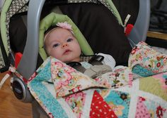 Duh! So smart! Car Seat Quilt that ties to the handle so baby can't kick it off.