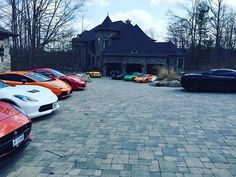 """The most epic driveway possibly in the history of driveways. #luxury #luxurylifestyle #luxurycars #luxurylife #luxurycar #cars #sportscar #ferrari #lamborghini #corvette #rich #expensivetaste #expensive #elite #exotic"" by @outofboundsluxury."