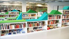 school library shelving | This library invites users to sit on the book shelves