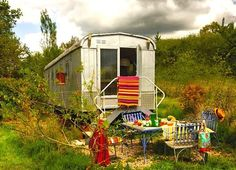 Pierre Arnoux has taken an old trailer and converted it into a brightly-colored happy hippy home in France