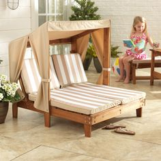 This chaise lounger is designed with kid-friendly proportions. The lounger features a three sided sun canopy to protect your child's skin while strong cotton and wood construction are designed to last