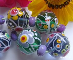 Lina Khan | Lampwork Beads: NOELIA - Colorful Rounds with Flowers and Butterflies