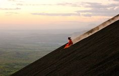 Like to snowboard or sled? Try volcano boarding! Made up of small, penny-sized volcanic rock, Cerro Negro, an active volcano outside León, Nicaragua, has become a destination for volcano boarding—either riding or surfing down its steep slope on a wooden sled. Adventurers first must hike up the volcano's 2,388 feet of loose rock, and then they can stand on their board like snowboarding or lie down on it like sledding, racing downhill at 30 mph.