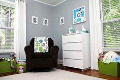 nursery with grey walls and green accents