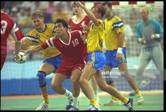 DOUICHEBAEV OF THE EUN FIGHTS OFF A CHALLENGE FROM TWO SWEDESH PLAYERS DURING THE FINAL OF THE MENS TEAM HANDBALL COMPETITION AT THE 1992 BARCELONA OLYMPICS.