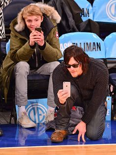 Star Tracks: Wednesday, December 3, 2014 | A GOOD SHOT | The Walking Dead's Norman Reedus gets some help from son Mingus in capturing the Brooklyn Nets vs. New York Knicks basketball game in N.Y.C. on Tuesday.