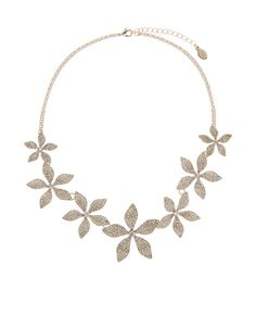 Our Beth statement necklace is garlanded with lilies, embellished with small-cut crystal gems for glamorous sparkle. Features a lobster clasp and extender chain.