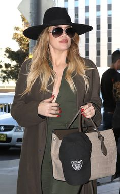 The gorgeous Khloe Kardashian kept a low profile under an oversized fedora, a chic trench coat and chic aviator shades!