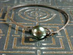Tahitian pearl leather bracelet lariat clasp men by PerlaMundi, €65.00  #tahitianpearls #tahitian #pearls #boho #bohemian #handdmade #organic #gypsy #jewels #madeinfrance #giftingluxury #blackpearls #surf #surferjewelry #surf #surfer #handmade #beach #jewelry #jewel #perlamundi #perla #mundi #bracelets #necklaces #earrings #tahiti