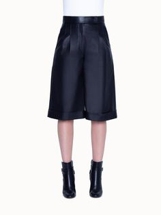 Impeccably crafted from the finest, ethically-sourced lamb nappa leather, these shorts are a must have for your wardrobe. Equal parts basic and edgy, these relaxed fit, wide leg culotte shorts feature a flattering high rise waist and a front zip. Culotte Shorts, Lamb, Most Beautiful, Cashmere, Short Dresses, Stylists, Zip, Tank Tops, Fitness