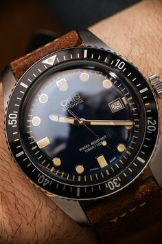 """Oris Divers Sixty-Five 42mm Watch Hands-On - by James Stacey - see the full photo gallery & read more on aBlogtoWatch.com """"High on my list of favorite watches from Baselworld 2016 is the Oris Divers Sixty-Five 42mm (aka 'Sixty-Five 42'). Sharing a few common traits with the previous smash-hit Divers Sixty-Five, this new 42mm model is a bit bigger and has an entirely different dial, with a more traditional dive watch layout and a lovely gradated blue coloring..."""""""