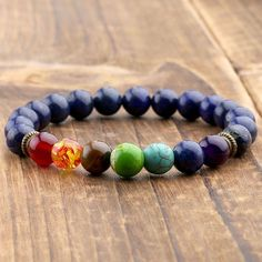 Authentic Lapis Lazuli 7 Chakra Reiki Prayer Healing Bracelet. Jewelry by Peace of Mindfulness. Chakras are used for balancing energy, cleansing and restoring energy through meditation practice. Plus, they look ultra stylish and make great fashion accessories for any outfit.