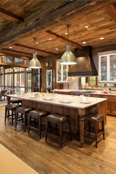 John Kraemer & Sons built this Northern Wisconsin cabin as a lake home with a bunkhouse nearby. Materials used include natural stone and reclaimed wood from Montana. There is no sheetrock in this entire house!