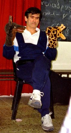 Marshall Rosenberg, creator of Nonviolent Communication using his giraffe/jackal puppets to illustrate
