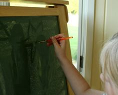 Painting with water on chalk is a great mess free activity for preschoolers!