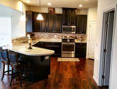 Ryan Homes Florence - Espresso cabinet's, Luxury vinyl Tile, Tan Back Splash & stainless steal hardware