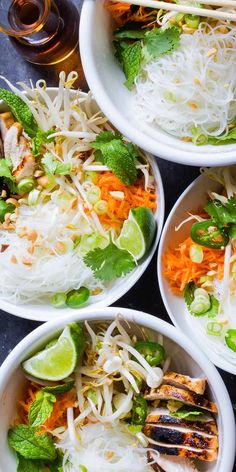 Vietnamese-Style Noodle Bowls with Chicken are the perfect meal in a bowl. Made with vermicelli rice noodles, chicken, fresh herbs and vegetables, and a tangy rice vinegar dressing.