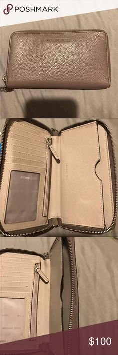 Michael Kors wristlets wallet Great condition. Can hold iPhone 7 Plus. Has a slot for your ID and can hold 6 credit/debit cards. Michael Kors Bags Clutches & Wristlets
