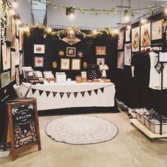 Enclosed booth with open ceiling and lighting with a sprinkle of plants. Pop up shops Vendor Displays, Craft Booth Displays, Booth Decor, Display Ideas, Booth Ideas, Market Displays, Stall Display, Jewelry Displays, Store Displays