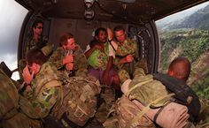 An Australian patrol extracted from the mountainous East Timor border region transports an extra passenger to the care of the INTERFET field hospital in Dili.  The young baby, suspected to be suffering from malaria.