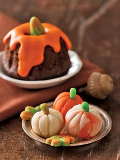 Marzipan pumpkins:  To make pumpkins, divide marzipan into three batches. With food coloring, tint one green and one orange; leave one natural. For mottling, combine batches. Roll pumpkin spheres, scoring lobes with a skewer. Cut leaves with mini cutters.