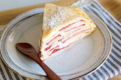 strawberry gâteau de crêpes; layers of golden soft new york times crepes were sandwiching the ruby red strawberries sliced and the oozing pale pastry cream from pierre herme