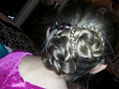 Two buns braids from side wrap around buns