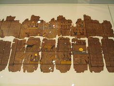 *PAGES FROM AN EGYPTIAN BOOK OF THE DEAD:a papyrus scroll,this one belonging to Amen-em-hat+written over 2,300 years ago in Thebes.It is 6 metres long+has been in the RoyalOntarioMuseum vaults for about a century,acquired in Egypt. Note the use of gold leaf.It is not common to find this in Books of theDead.From wikipedia: The Book of Dead;is the common name for the ancient Egyptian funerary text known asSpells of Coming(or Going)The Book of the Dead was a description of the ancient…