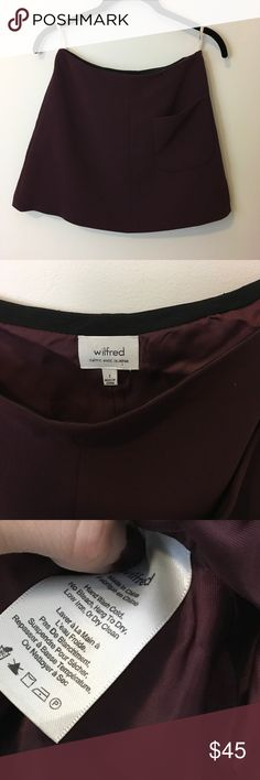 Wilfred Aritzia Plum Red A-Line Pocketed Skirt Aritzia skirt by Wilfred - Plum reddish color and a-line style ....super vintage like and structured. Lined and has a pocket on the front. Size 2. Aritzia Skirts Mini