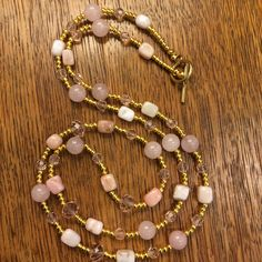 Pink opal, rose quartz, pink crystal faceted beads and gold plated beads.
