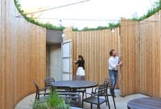 The garden patio of the Peppino Restaurant, designed by Atelier 111 Architekti, has the plants planted between its outer and inner shell. Gable Wall, Wooden Slats, Premium Wordpress Themes, Organic Shapes, Greenery, Terrace, Deck, Homes, Patio