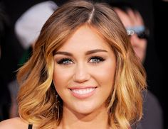 If you love down 'dos…  Just barely curl it in front like Miley Cyrus did.