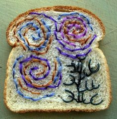 Embroidered Bread -Embroidery artist Catherine McEver is the creator who uses sliced bread as canvases. Why? She says we have to read Umberto Eco's Travels in Hyperreality to understand.