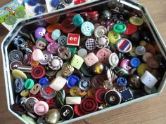 Tin full of colourful & quirky vintage buttons. noelhumphrey on eBay.
