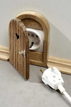 Wee faerie door - hehe this is just cute ... mouse hole door to conceal electrical outlets ... except for those in use all the time, it would make it more obtrusive. But for an occasionally-used outlet especially in a cottage-y room, this is darling! I'm thinking sewing room ...